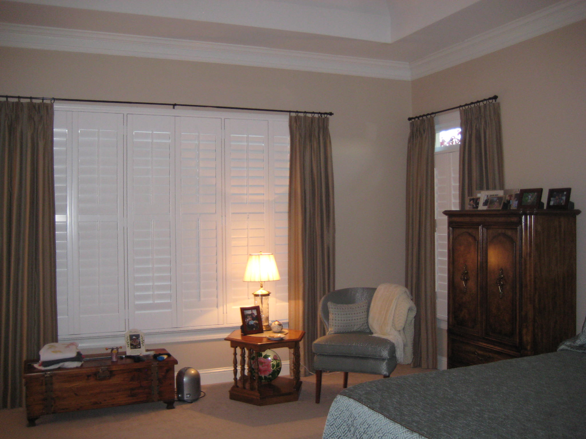 Bedroom Make over. Window treatment and shutters help insulate the home for the winter and summer.