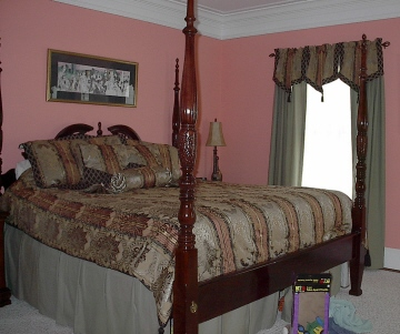 Bedroom - Coordinated bedding and window treatments.