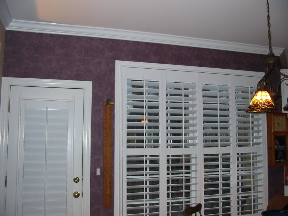 Before Kitchen Window Treatments and shutters were installed.
