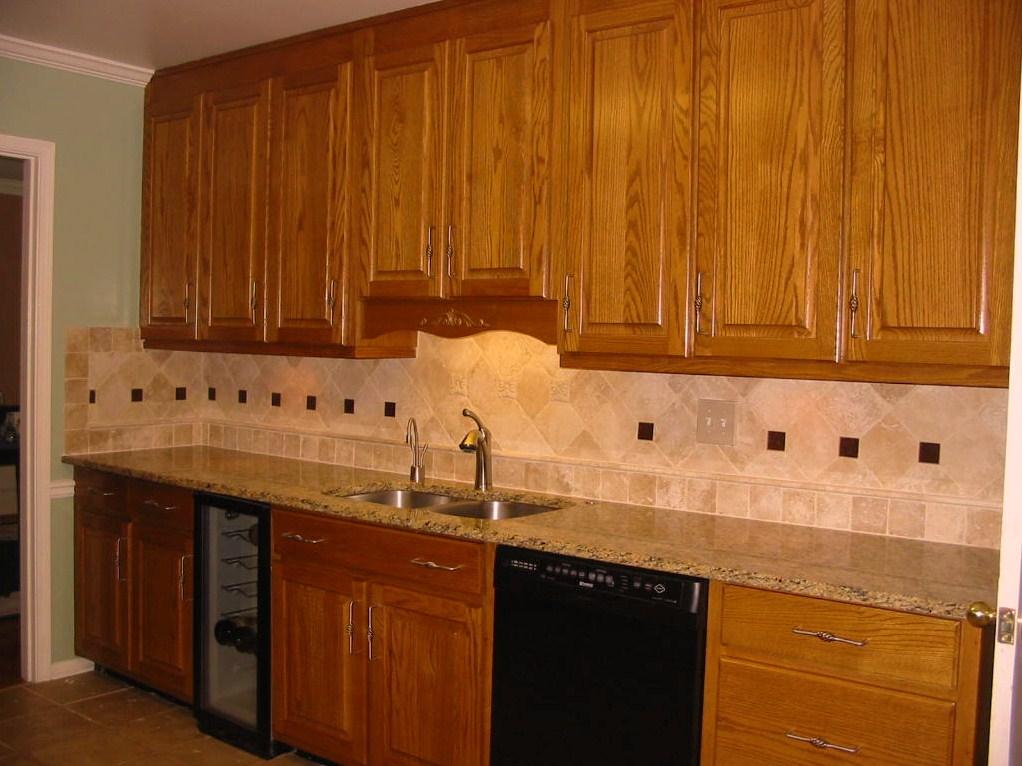 Kitchen - Renovation - Tile backsplash, cabinets, granite.