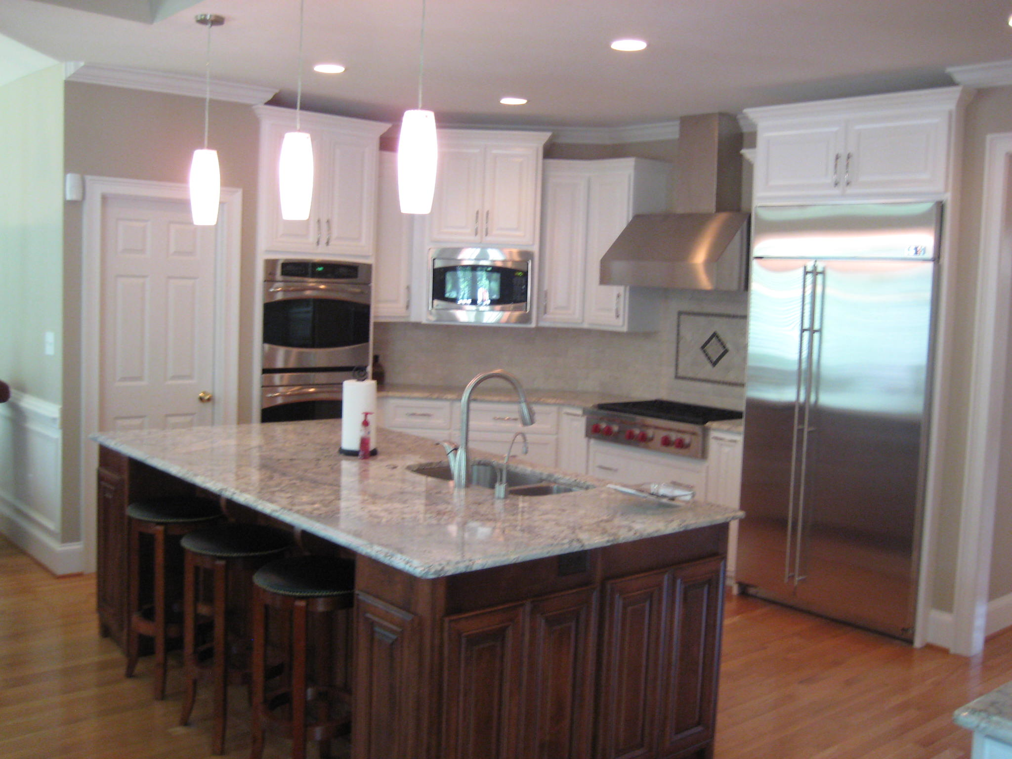 Kitchen renovation with appliances, granite and more.
