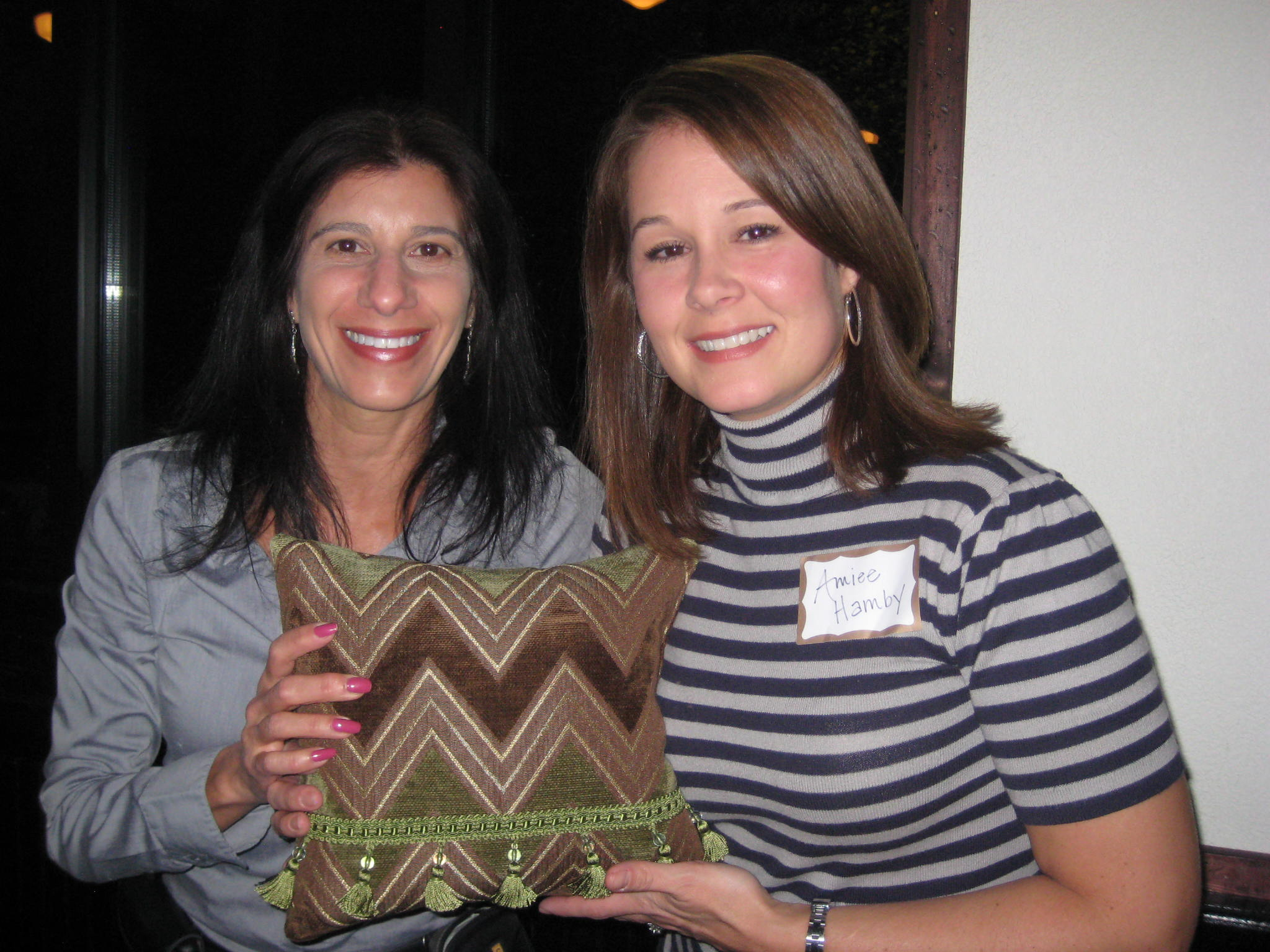 Julia Virga with WWC door prize donation winner to help her accessorize her home.