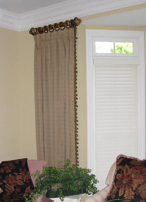 Living Room - Pleated Panles w/trim using short wooden pole.