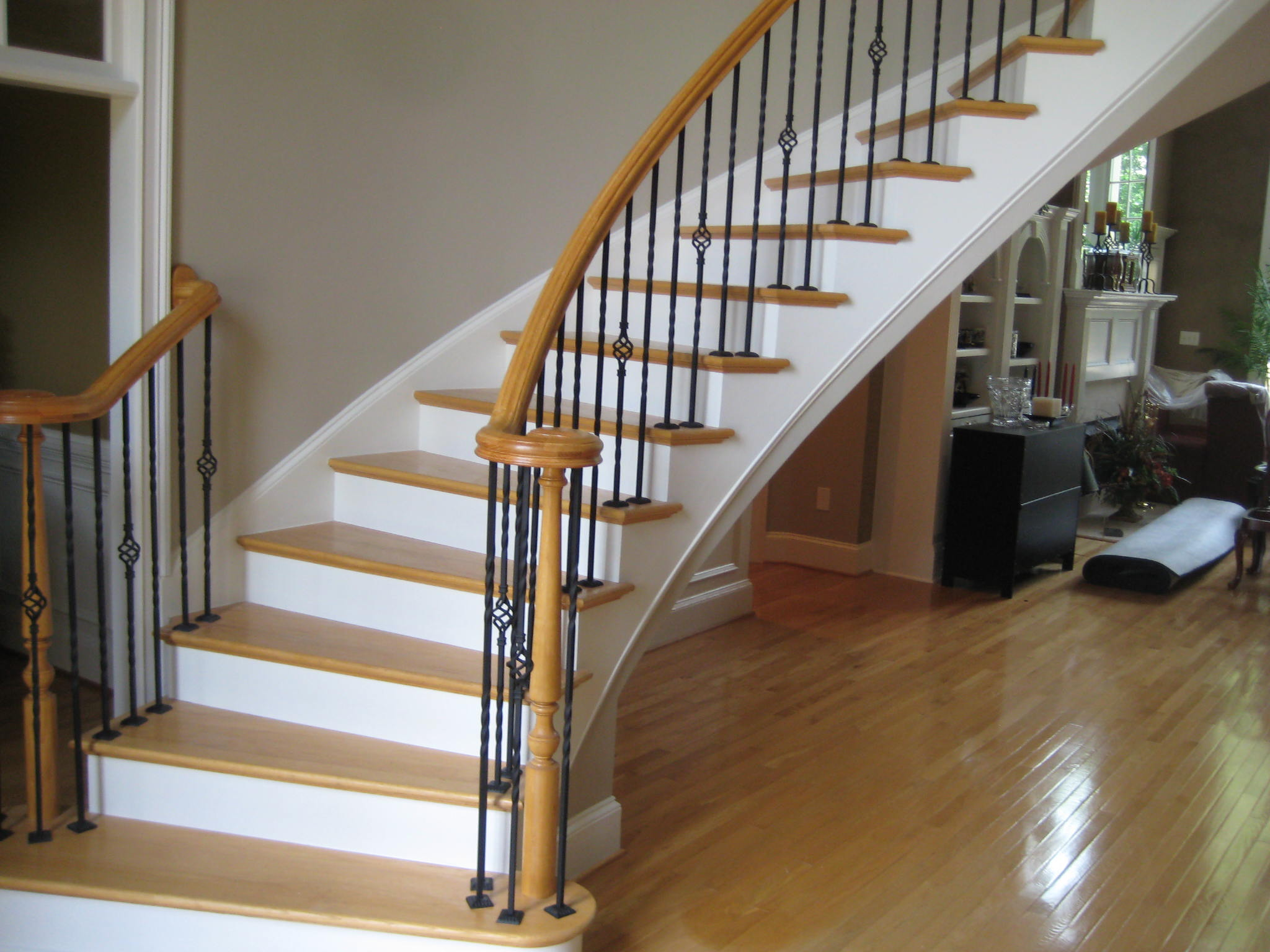 Iron Balusters enhances elegant staircase.