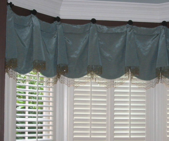 Living Room - Window Treatment hung on beautiful Swagholders w/beads