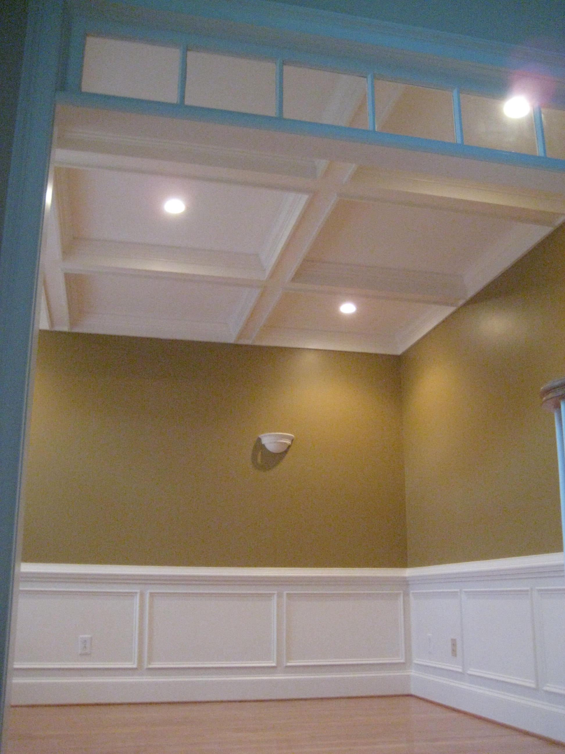 Remodel Living Room wall light sconces enhance coffered ceiling.