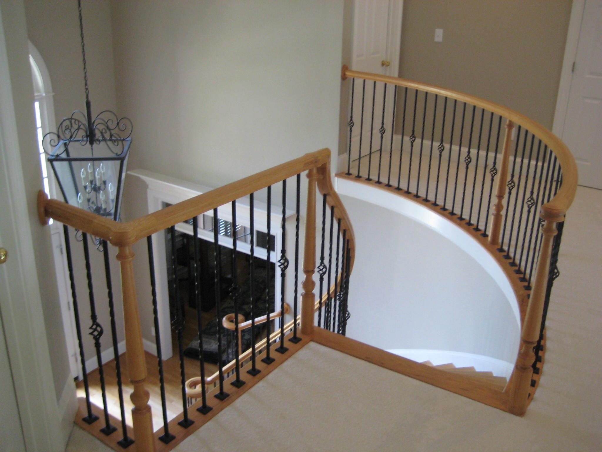 Iron Balusters enhances this elegant staircase.