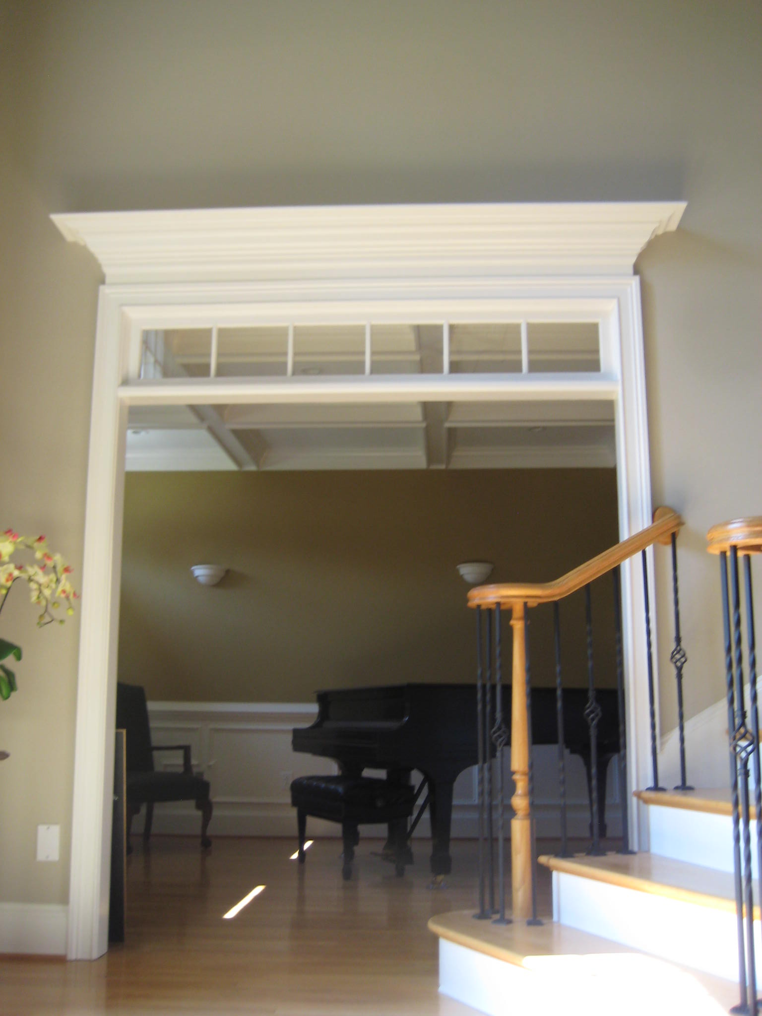 Remodeling Living Room doorway by removing doors and adding top trim molding and more.